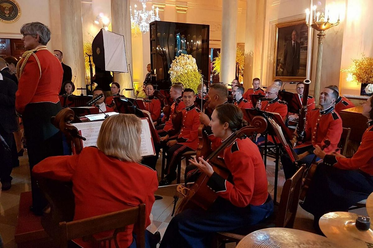 The Marine Corp band awaits Mr Lee Hsien Loong, Mrs Lee, President Barack Obama and Mrs Michelle Obama in the grand foyer of the White House.