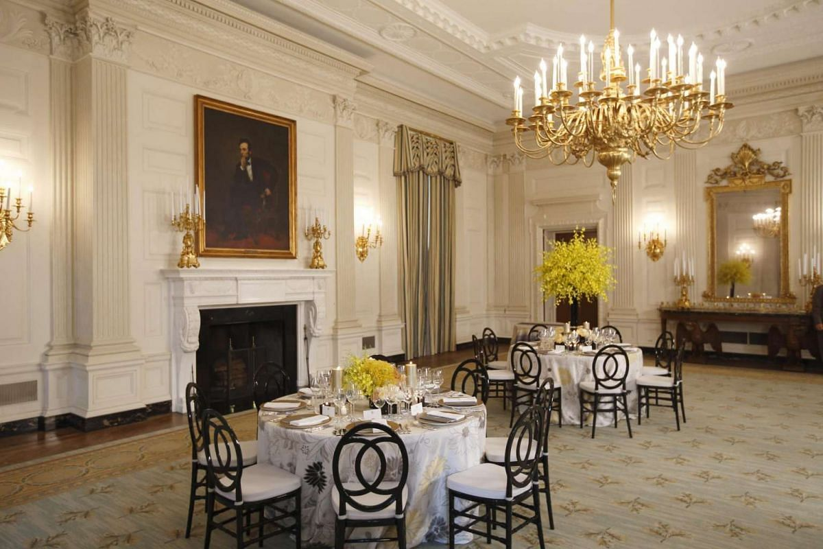 Examples of table settings are shown in the White House's State Dining Room during a media preview on July 29 for the upcoming state dinner for Prime Minister Lee Hsien Loong.