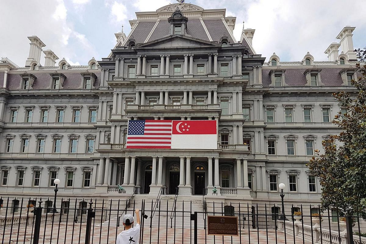 A Singapore flag and a US flag hanging in the front of the Eisenhower Executive Office Building in preparation of Prime Minister Lee Hsien Loong's official visit and state dinner.
