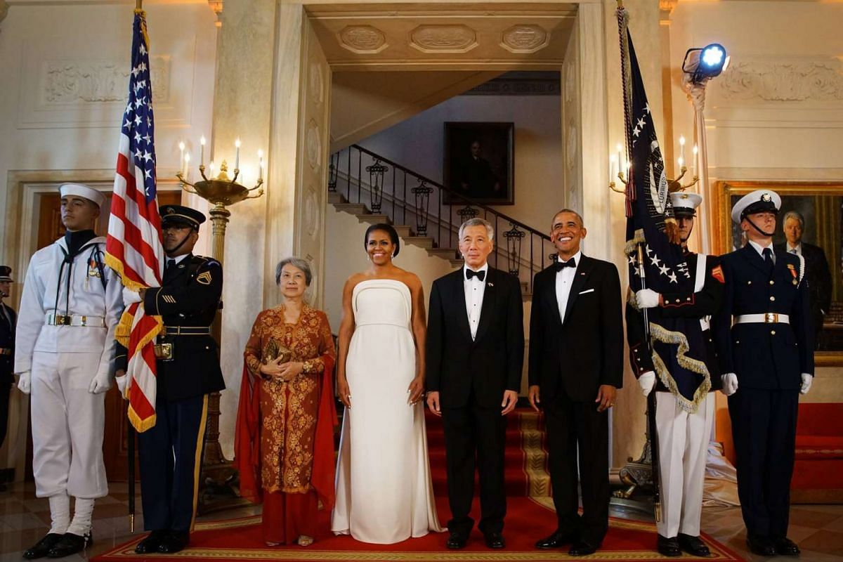 (From left) Mrs Lee, First Lady Michelle Obama, Prime Minister Lee Hsien Loong and President Barack Obama pose for photos before the State Dinner at the White House on Aug 2, 2016.