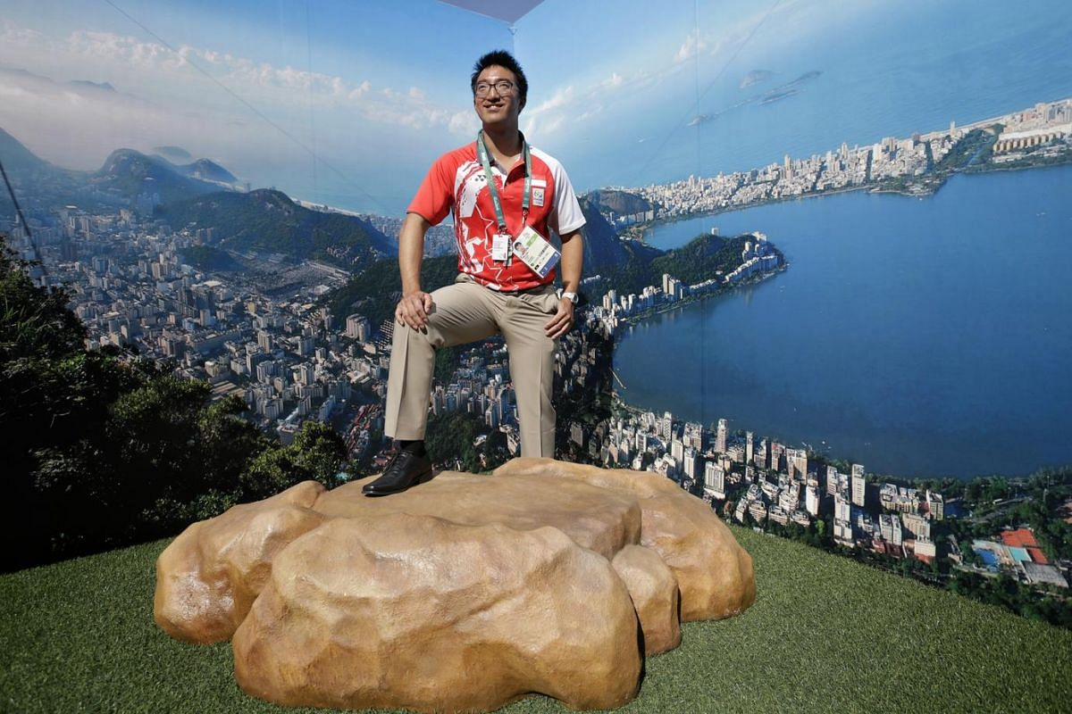 Team Singapore sailor Colin Cheng posing for a photo at a wall depicting the scenery of Rio de Janeiro after the welcome ceremony at the Olympic Village on August 2.
