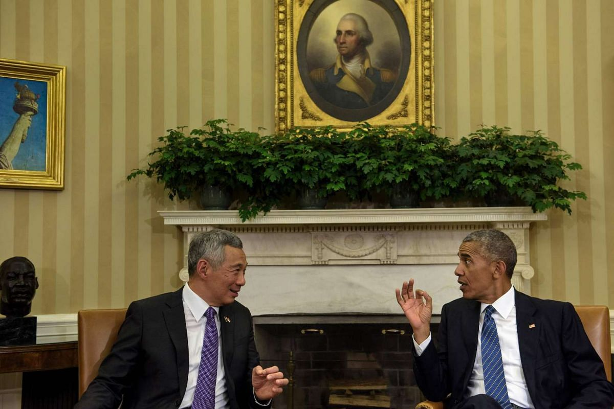 Singapore Prime Minister Lee Hsien Loong (left) and US President Barack Obama speak before a meeting in the Oval Office of the White House on August 2.
