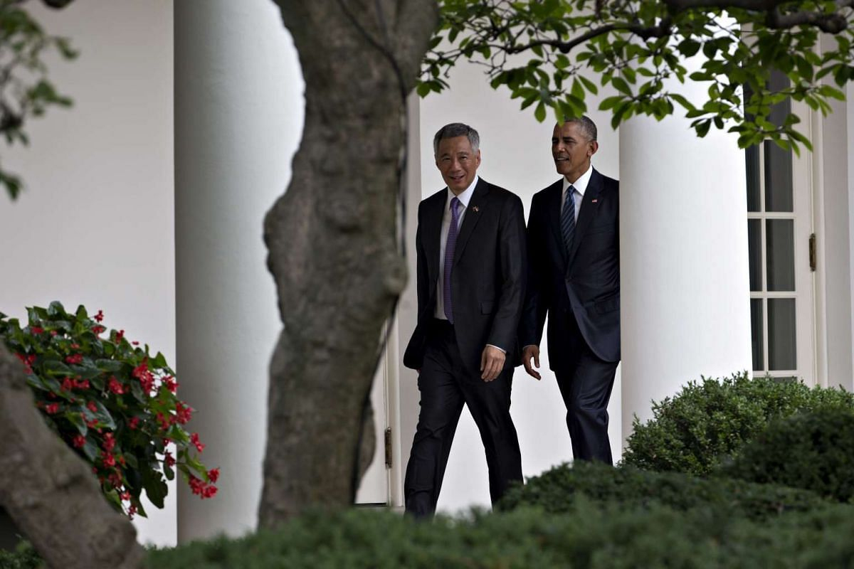 Us President Barack Obama and Singapore Prime Minister Lee Hsien Loong walk to the Oval Office after participating in an official arrival ceremony at the White House on August 2.