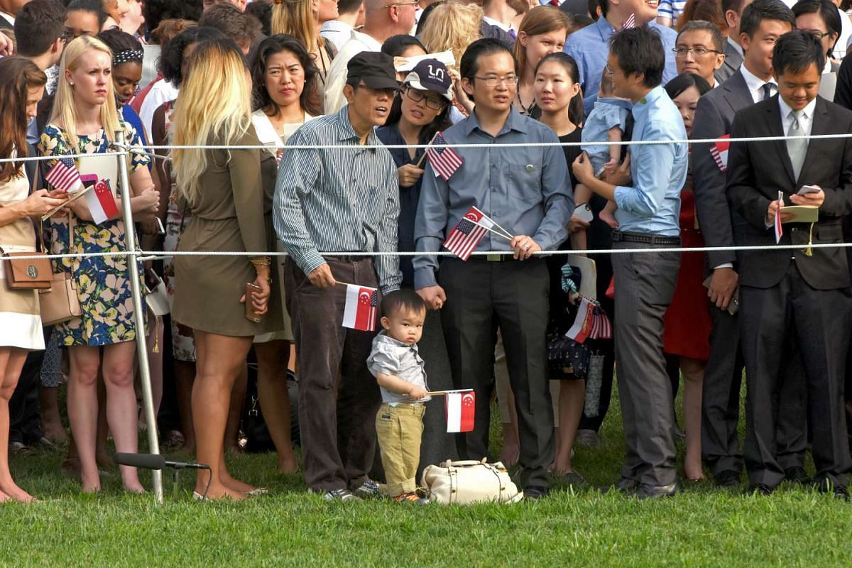 Supporters look on during the welcome ceremony for Singapore Prime Minister Lee Hsien Loong and Mrs Lee at the White House on August 3.