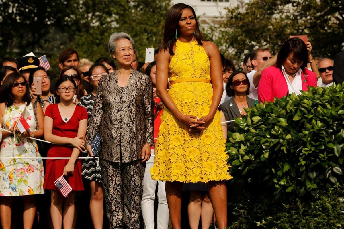 US first lady Michelle Obama and Mrs Lee Hsien Loong stand together during an official arrival ceremony on the South Lawn of the White House in Washington on August 2.