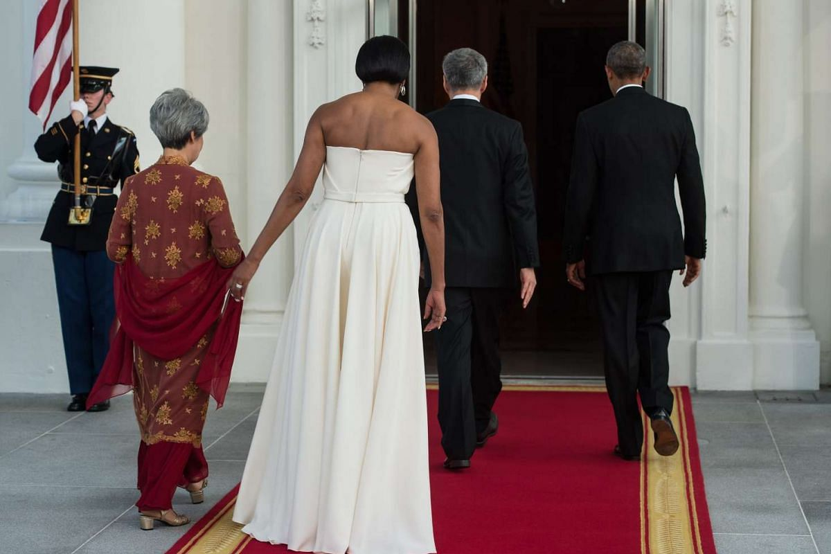 US President Barack Obama (right) and First Lady Michelle Obama (second from left) with Singapore's Prime Minister Lee Hsien Loong (second from right) and Mrs Lee for a state dinner at the White House on Aug 2, 2016.