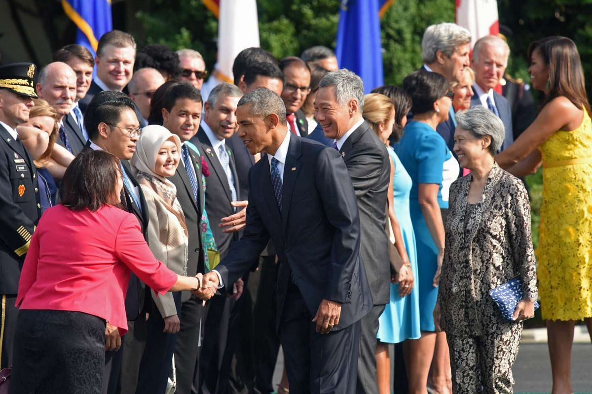 Mr Obama shaking hands with members of the Singapore delegation.