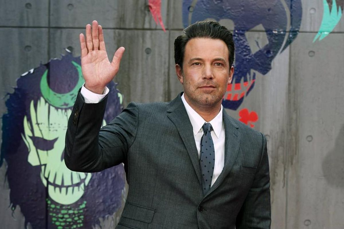 Ben Affleck, who reprises his role as Bruce Wayne aka Batman in the movie, waves to the crowd at Leicester Square.