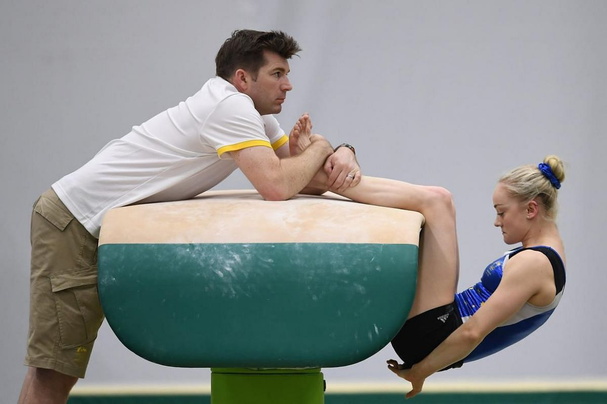 Australian Olympic Gymnast Larissa Miller trains with her personal coach John Hart at Athlete's Park ahead of the Rio 2016 Olympic Games in Rio de Janeiro, Brazil, August 3.