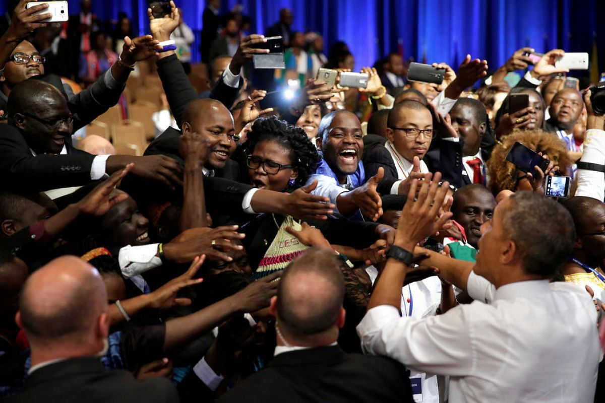 US President Barack Obama (R) calms the crowd at a Young African Leaders Initiative town hall in Washington on August 3.