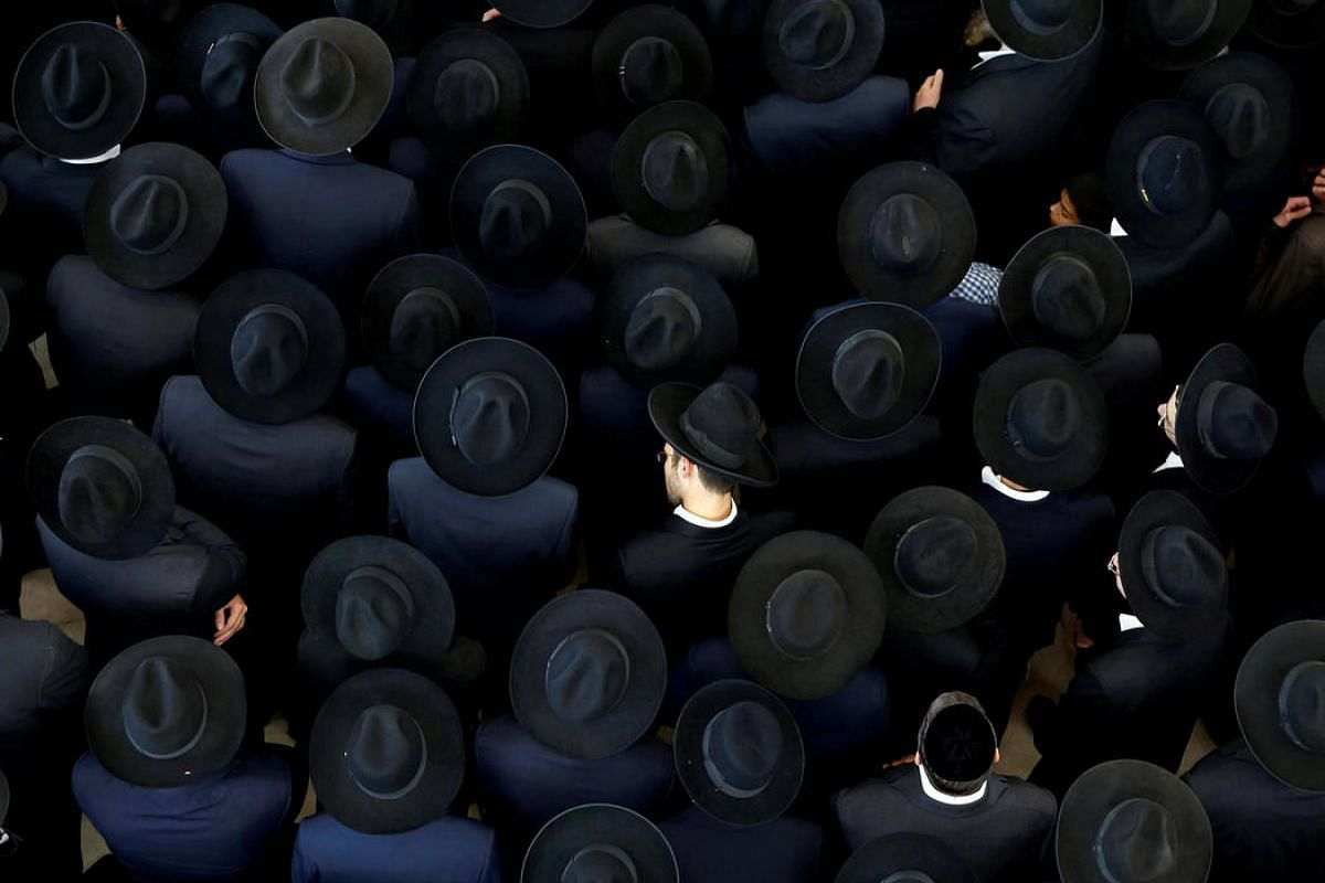 """Ultra-Orthodox Jewish men take part in the funeral ceremony of Rabbi Moshe Mordechai Chadash, head of the """"Or Alhanan"""" Jewish Seminary, in Jerusalem August 3."""