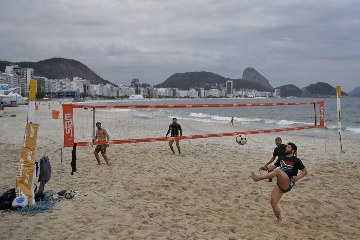 Locals playing foot-volleyball at the beach in Copacabana in Rio de Janiero, Brazil, on August 3.