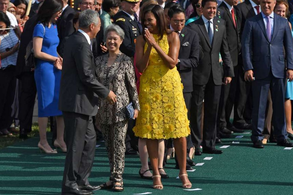 President Obama and Mrs Obama welcoming Prime Minister Lee and Mrs Lee to the White House on August 2.