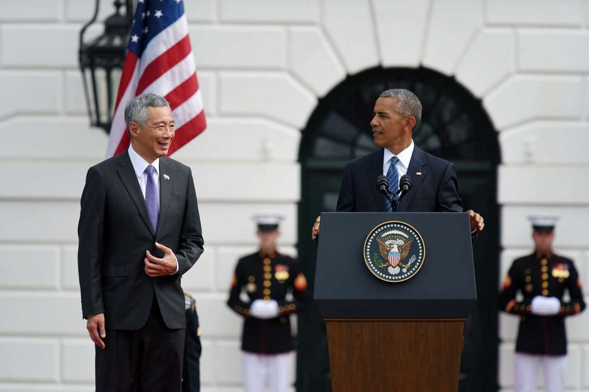 President Obama speaks during the White House welcome ceremony for Prime Minister Lee and Mrs Lee.