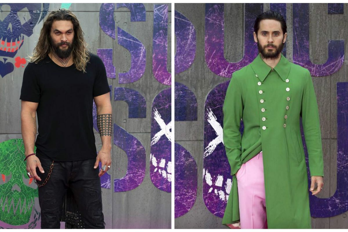 Actor Jason Momoa goes casual scruffy for the premiere while Jared Leto gets Victorian dandy in his green frockcoat and pastel pink pants.