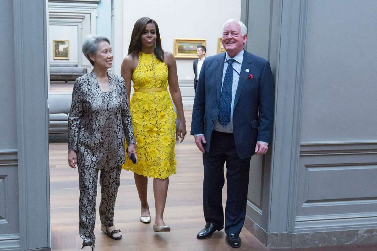 """Mrs Lee Hsien Loong (left) and US First Lady Michelle Obama are escorted through the National Gallery of Art in Washington DC by Museum Director Earl """"Rusty"""" Powell III on August 2."""