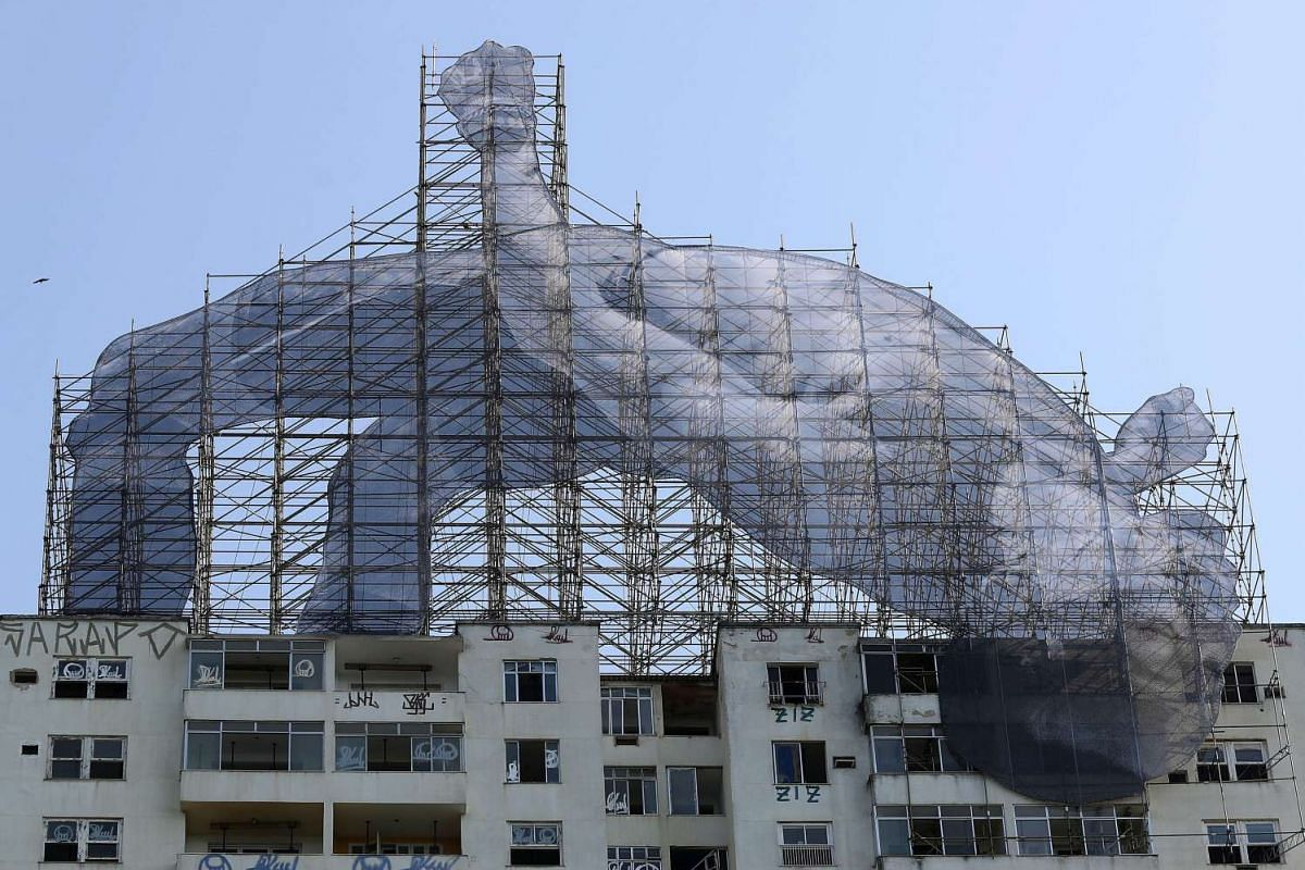 A giant installation is installed by the French artist JR at the former headquarters of Clube de Regatas do Flamengo in Rio de Janeiro, Brazil, August 4.
