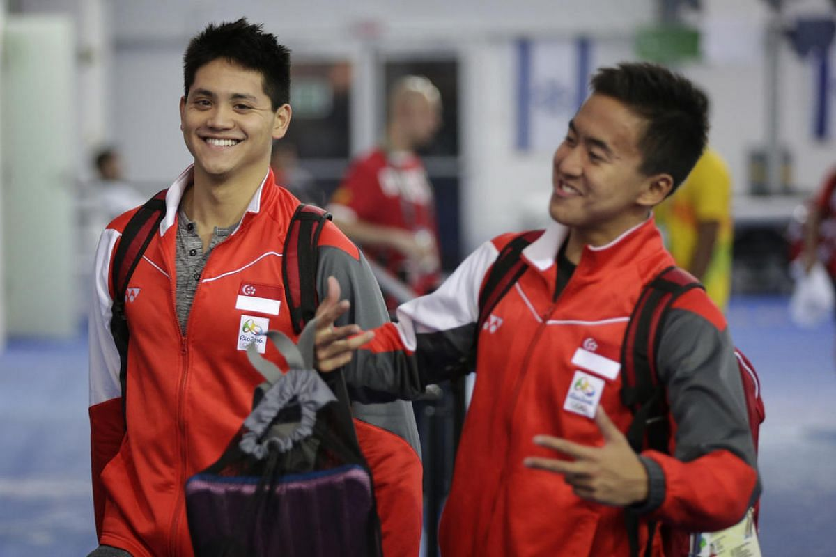 Singapore's Joseph Schooling and Quah Zheng Wen share a light moment on August 4 after training ahead of their swimming competition.