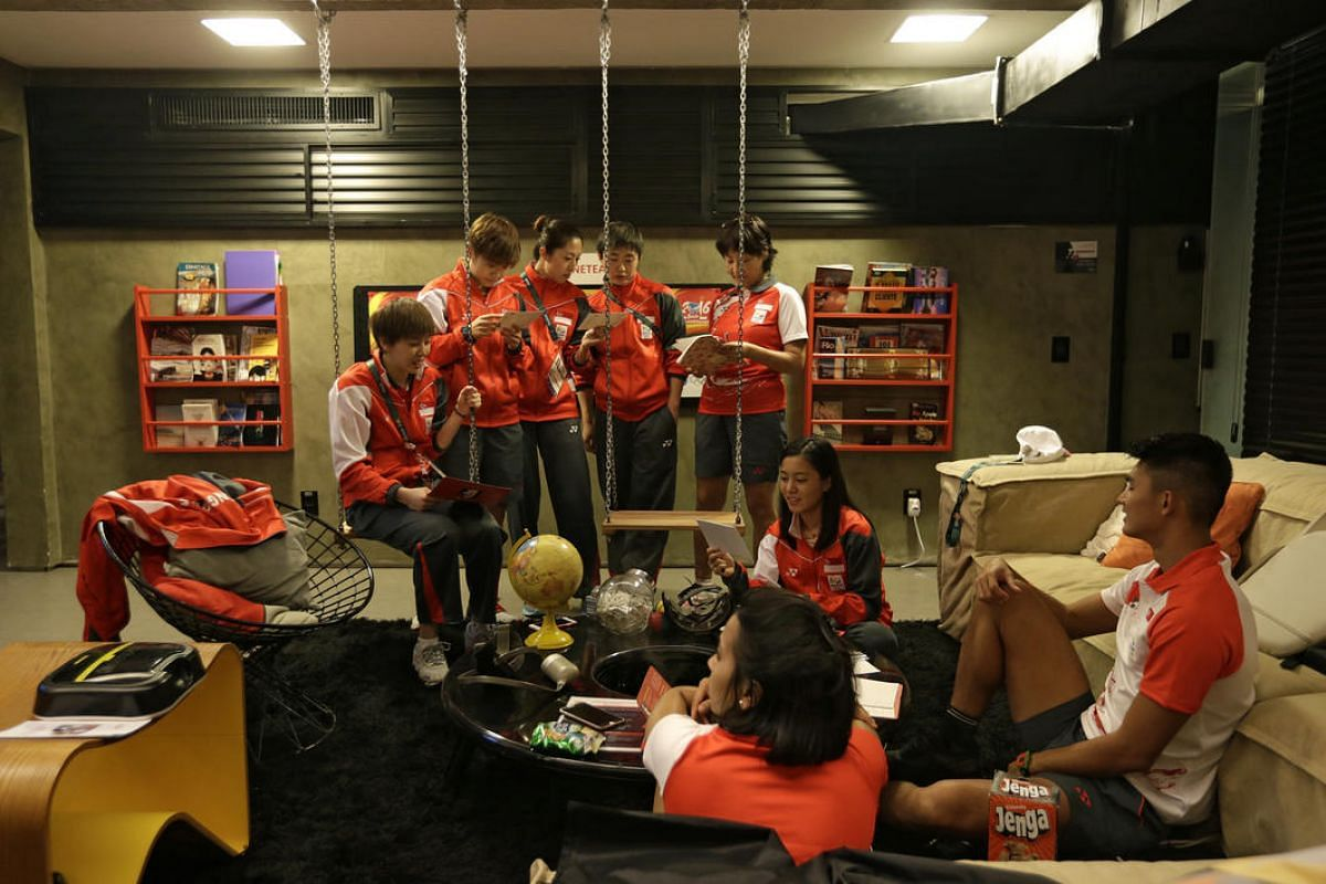 Team Singapore athletes relaxing in the basement of Singapore House on August 4.