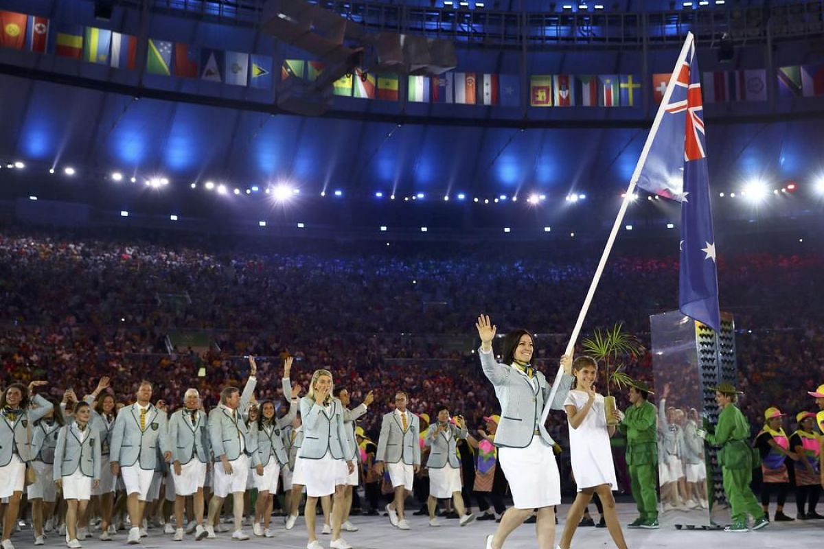 Flagbearer Anna Meares of Australia arrives for the opening ceremony.