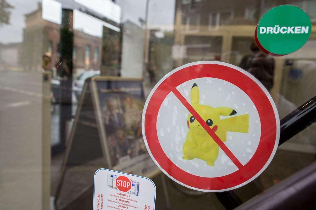A warning sticker banning Pokemon Go at a branch of Volksbank Neuss in Duesseldorf, Germany, on Aug 3. The bank banned the game in all 23 branches due to worries about data protection and discretion.