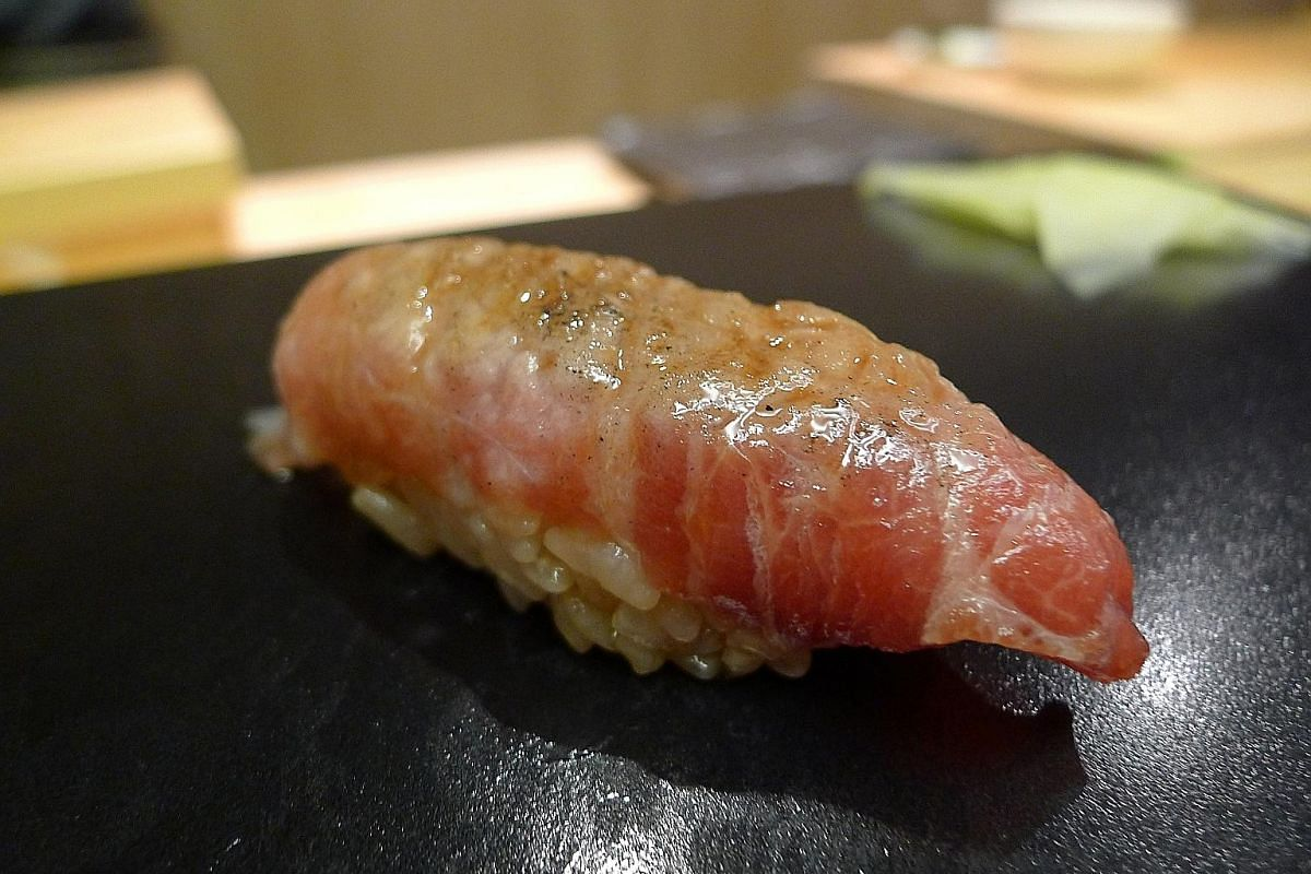Shoukouwa's aburi tuna cheek sushi (above) and mackerel with soya sauce (left).