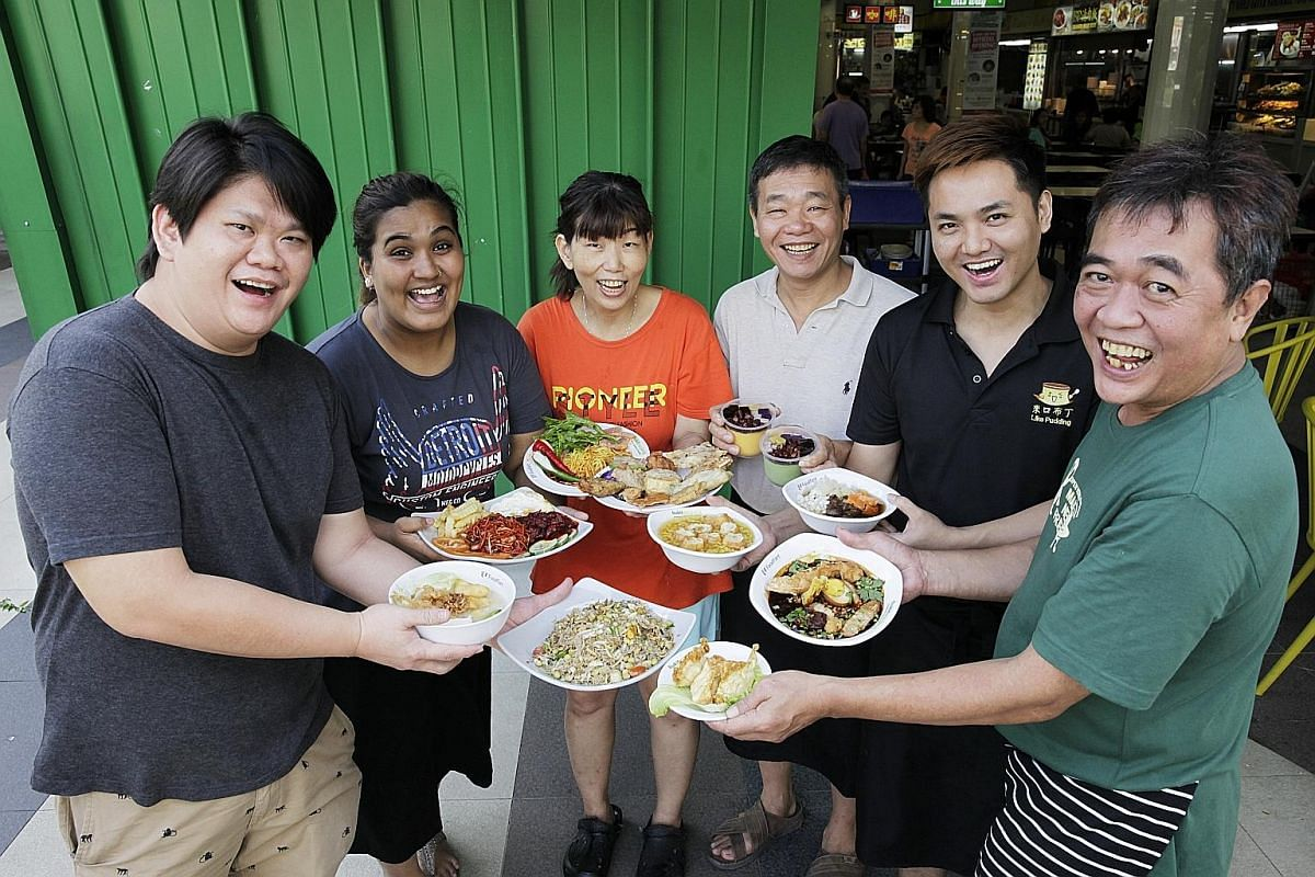 Winning hawkers from Bukit Panjang Hawker Centre and Market's Residents & Foodies' Choice Award (from far left) include Mr Ng Lee Tuck of 169 May Fish Soup; Ms Siti Sahra Said Mohamed of Habib Sahra Indian Muslim Food; Ms Tan Lay Geok of Beauty World