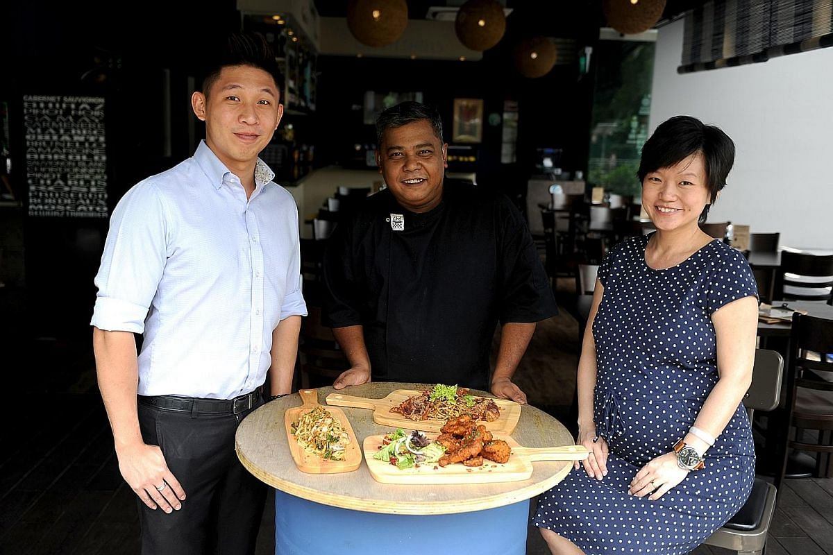 Gills N Shells, which serves fusion dishes such as hae bee hiam pasta with soft shell crab (left), is run by (above from left) founder Jayson Tan, executive chef Podisingho Xavier and general manager Coreen Tan.