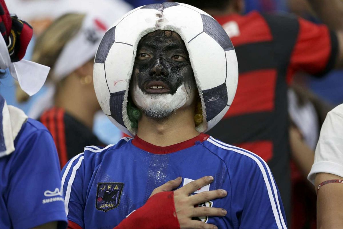 A Japanese supporter pledging during soccer preliminary at Amazonia Stadium for the Rio 2016 Olympic Games on Aug 7, 2016.