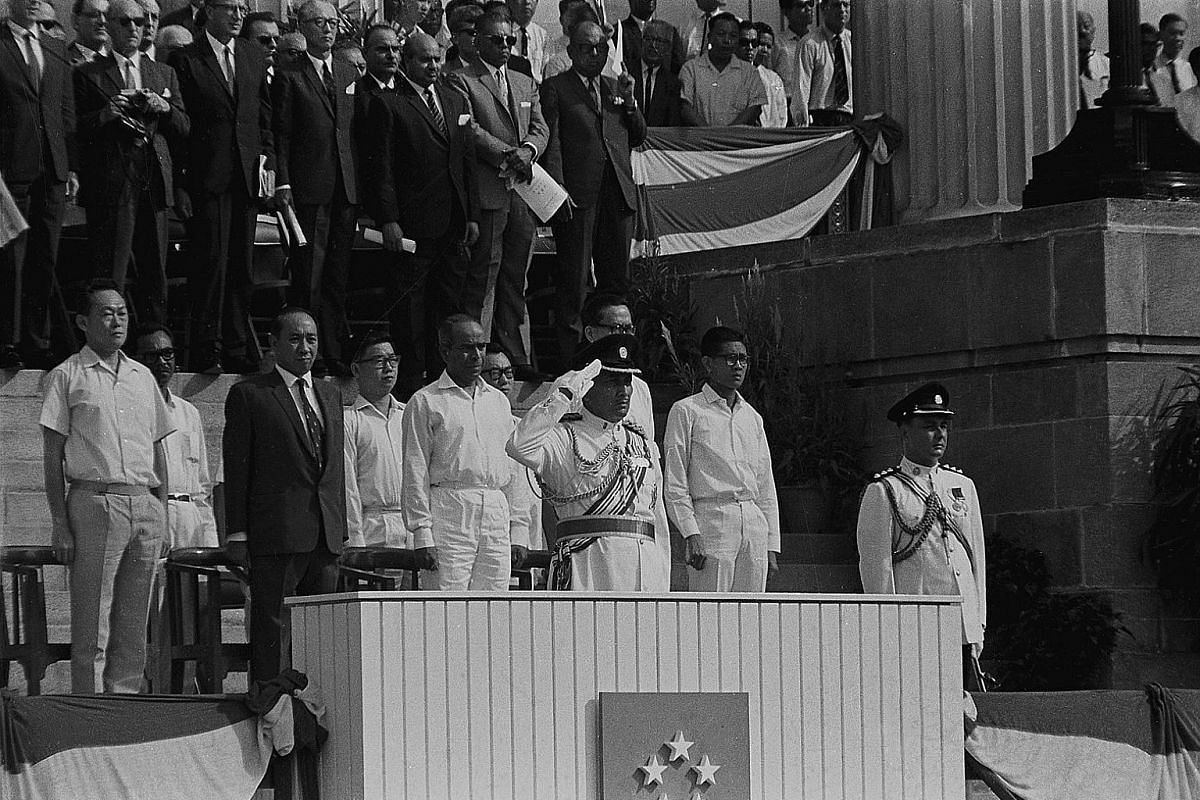 1966: Singapore's first National Day Parade kicks off at 9am at the Padang. President Yusof Ishak, resplendent in military uniform, takes the salute, with PM Lee Kuan Yew and ministers behind him. The parade features 23,000 participants and a militar