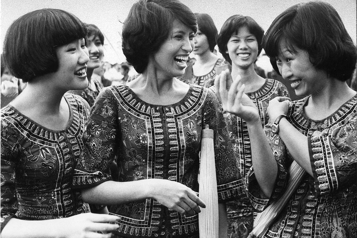 Clockwise from above: The Singapore Girl Pipers practising at the People's Association for NDP 1970; a Singapore Airlines stewardess stealing a last glance in the mirror before the start of the parade in 1976; Rangoon Road Secondary School students d