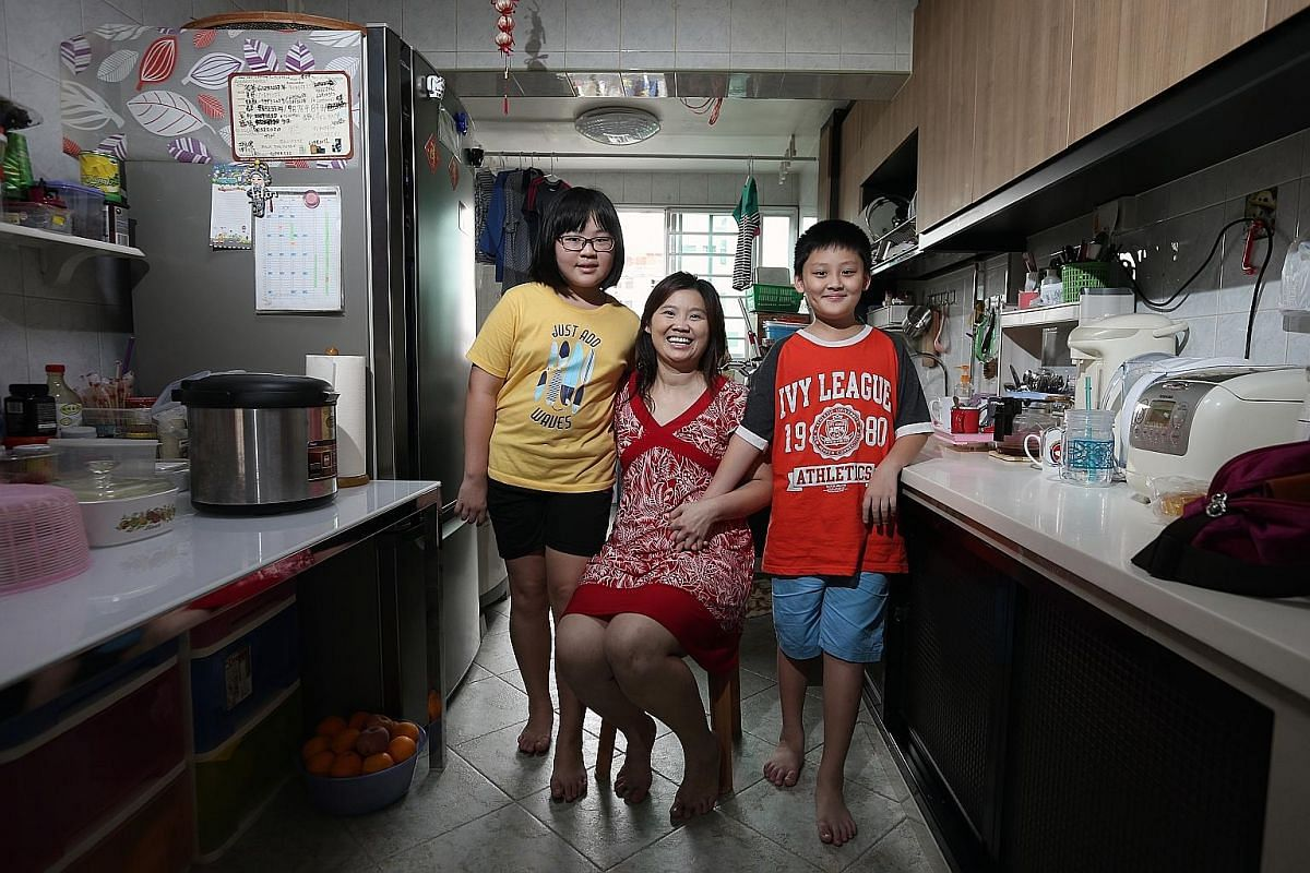 Madam Zhang with her children, Kristine, 11, and Kaleb, 10. Mr Zhou is overseas.