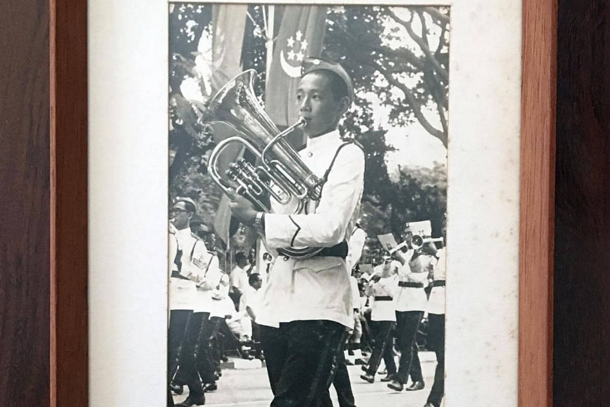 PM Lee's first NDP was in 1967, when he marched in a Combined Schools band. His grandmother framed up a picture of him marching with the euphonium, which he has kept till this day.