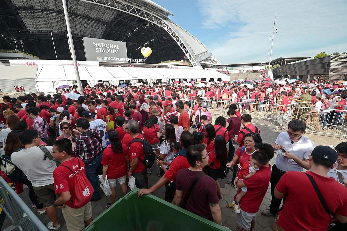 Parade-goers queue up for a security check prior to entering the National Stadium.