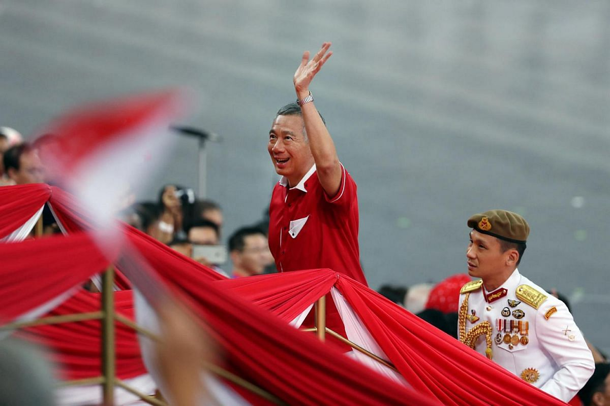 Prime Minister Lee Hsien Loong arrives at the stadium.