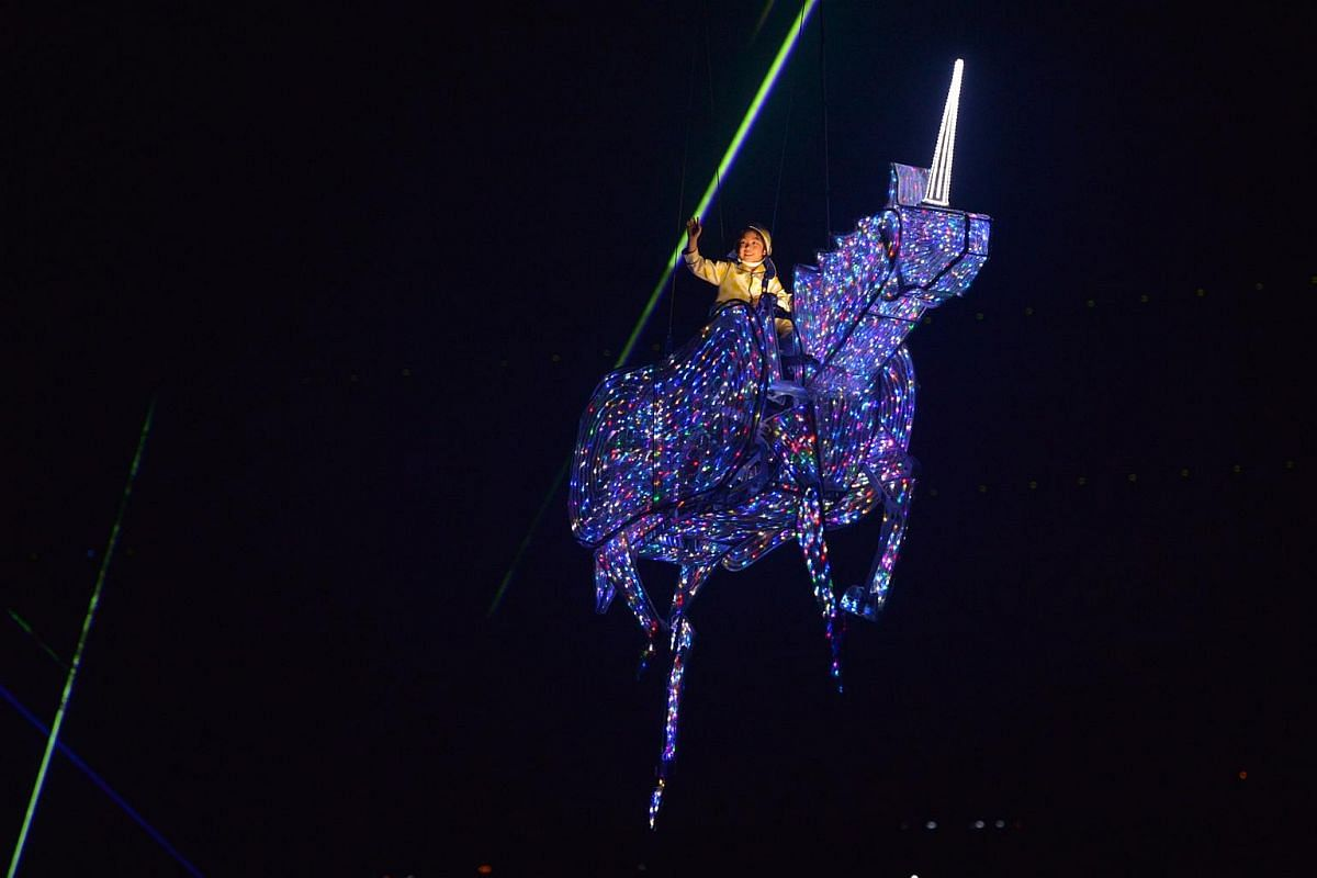 The highlight of Act 3's Dare to Dream - a glittery unicorn ridden by 7-year-old Minejima-Lee Kai gallops across the stadium.