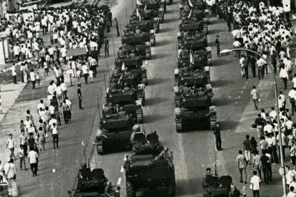 Tanks – which reportedly left track marks on the road – rumbling down a street during the parade in 1971. The mobile column consisted mostly of armoured personnel carriers, light tanks and mobile artillery.