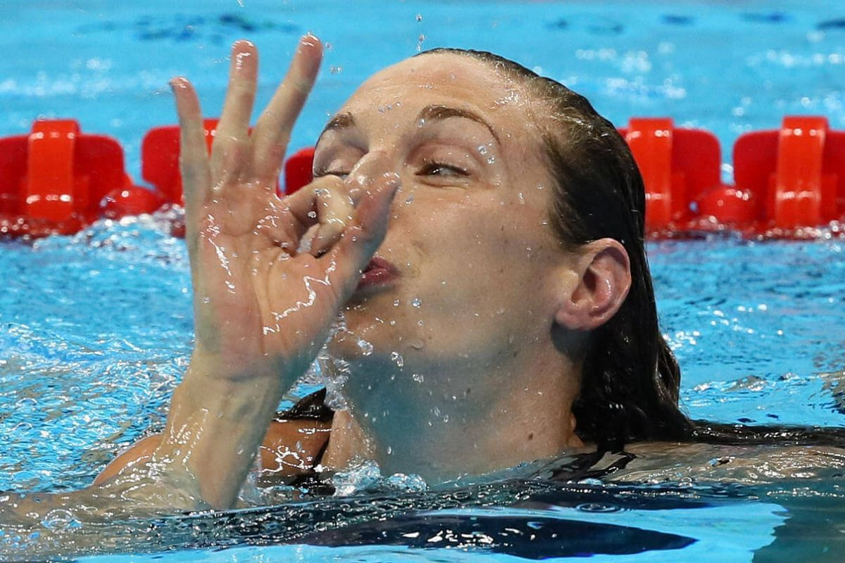 Hungary's Katinka Hosszu gestures the number three after winning the women's 200m indiividual medley final of the 2016 Rio Olympics on August 9.