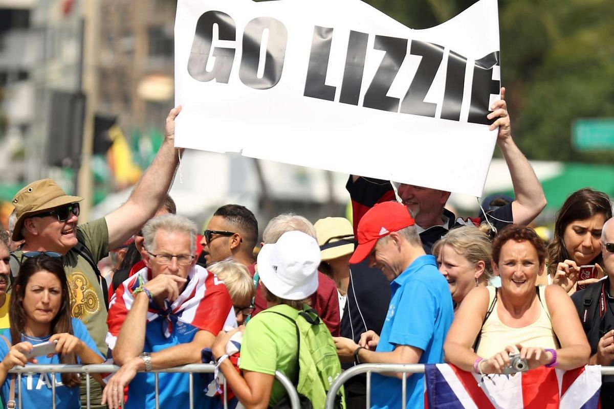Fans including John Armistead (second from left), father of Britain's cyclist Elizabeth Armitstead wait for the start of the Women's road cycling race at Fort Copacabana in Rio de Janeiro on Aug 7, 2016. Armitstead finished in fifth place.