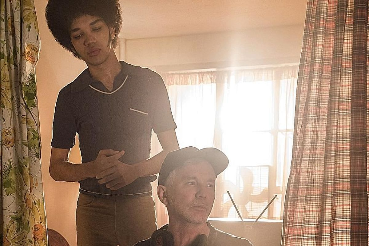 """Director Baz Luhrmann with Justice Smith, who plays Ezekiel """"Books"""" Figuero in The Get Down."""