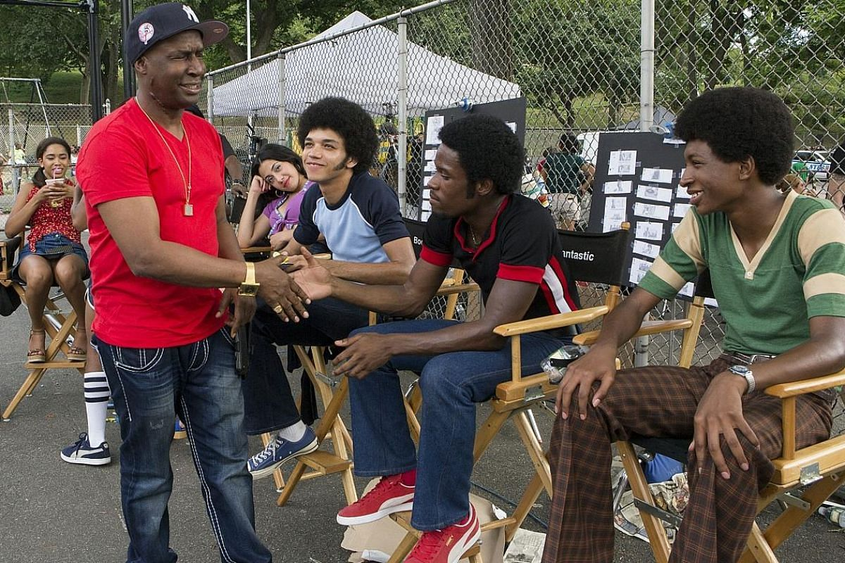 The Get Down features characters based on real hip-hop pioneers such as Grandmaster Flash (left, on set with the cast) and was created with their help.