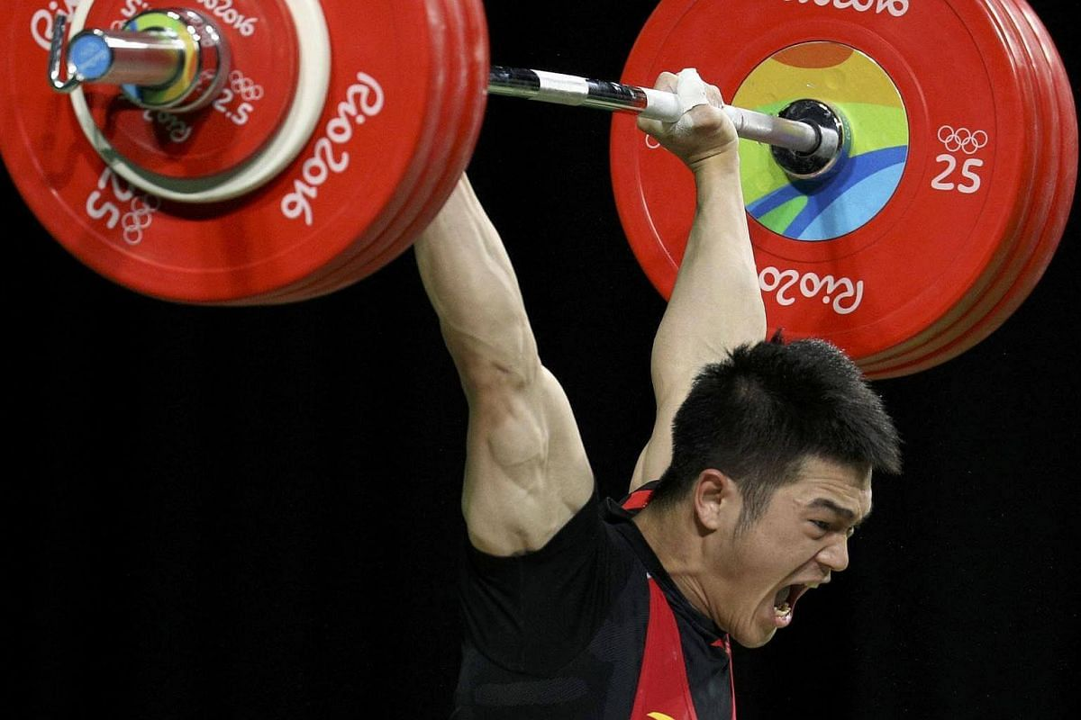 Shi Zhiyong of China competes during the men's weightlifting final at the Rio Olympics on August 9.