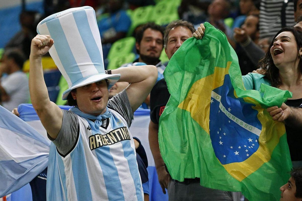 Argentina team fans cheer in the stands during the men's preliminary group B basketball game between Nigeria and Argentina of the 2016 Rio Olympic Games on August 7.