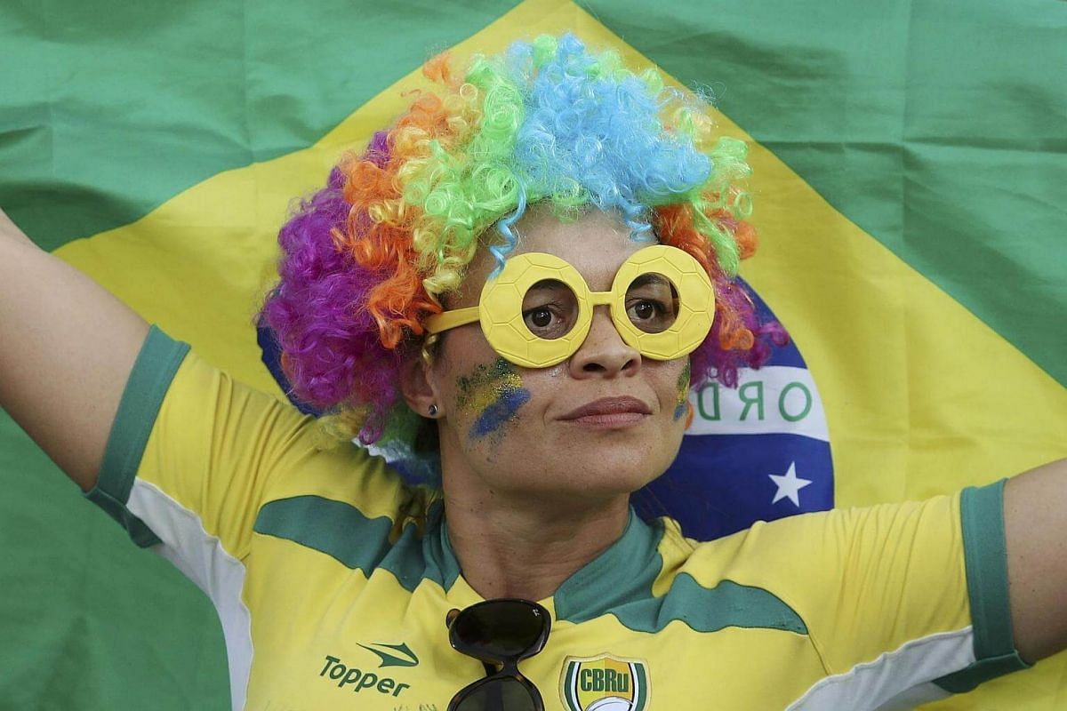 A Brazil fan shows her support at the women's rugby match during the 2016 Rio Olympics.