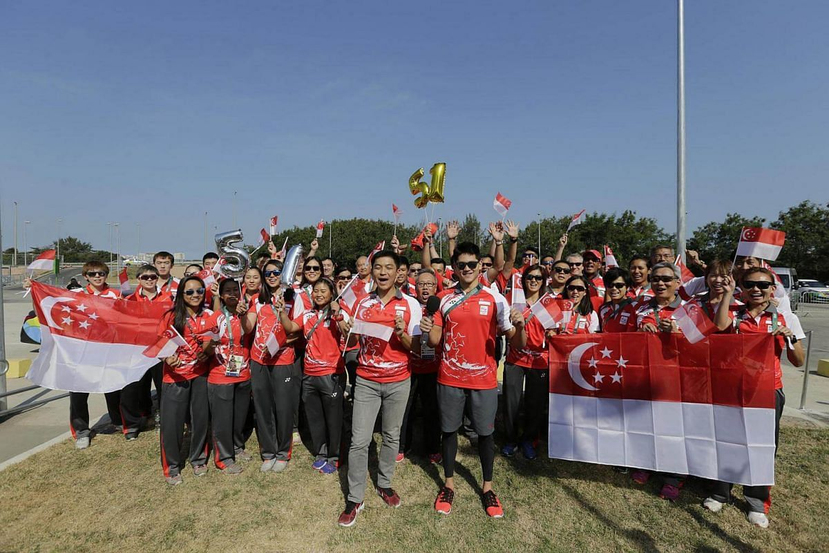 Minister for Social and Family Development Tan Chuan-Jin and swimmer Joseph Schooling leading Team Singapore in wishing Singapore a happy 51st birthday during a recording at the Olympic Village in Rio de Janeiro, Brazil, on Aug 5, 2016.