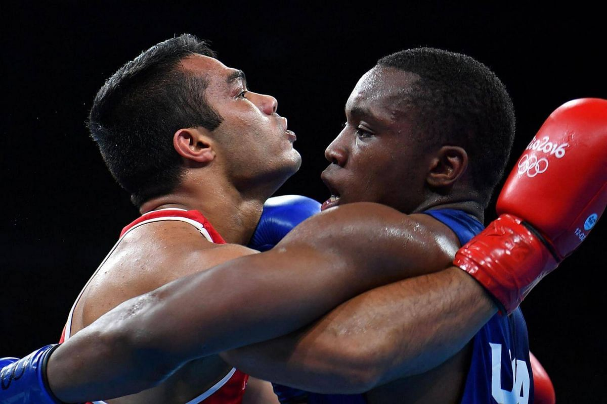 USA's Charles Albert Shone Conwell (right) fights India's Krishan Vikas during the Men's Middle (75kg) match at the Rio 2016 Olympic Games at the Riocentro in Rio de Janeiro on August 9, 2016.