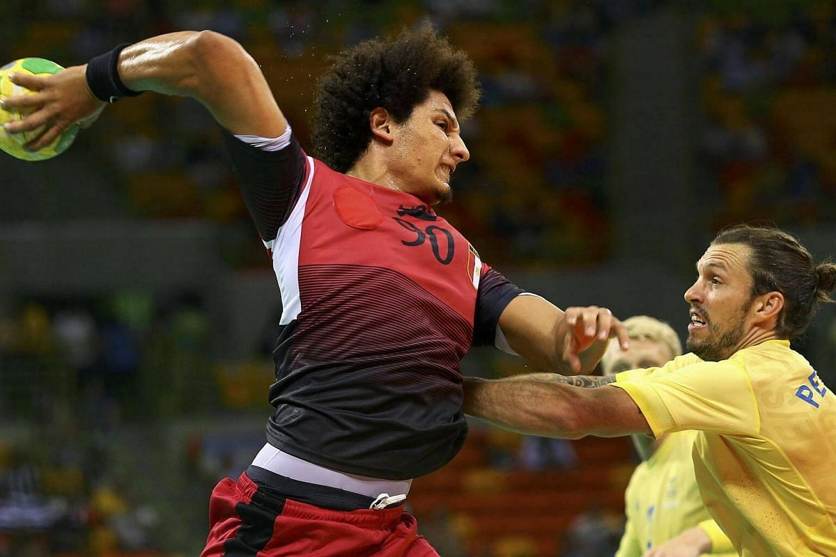 Ali Ali Ismail of Egypt and Fredrik Petersen of Sweden in action during the men's preliminary handball at the 2016 Rio Olympics.