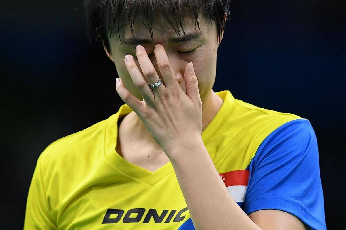 Singapore's Feng Tian Wei reacts between points against Japan's Ai Fukuhara in their women's singles quarter-final table tennis match at the Riocentro venue during the Rio 2016 Olympic Games in Rio de Janeiro on August 9.