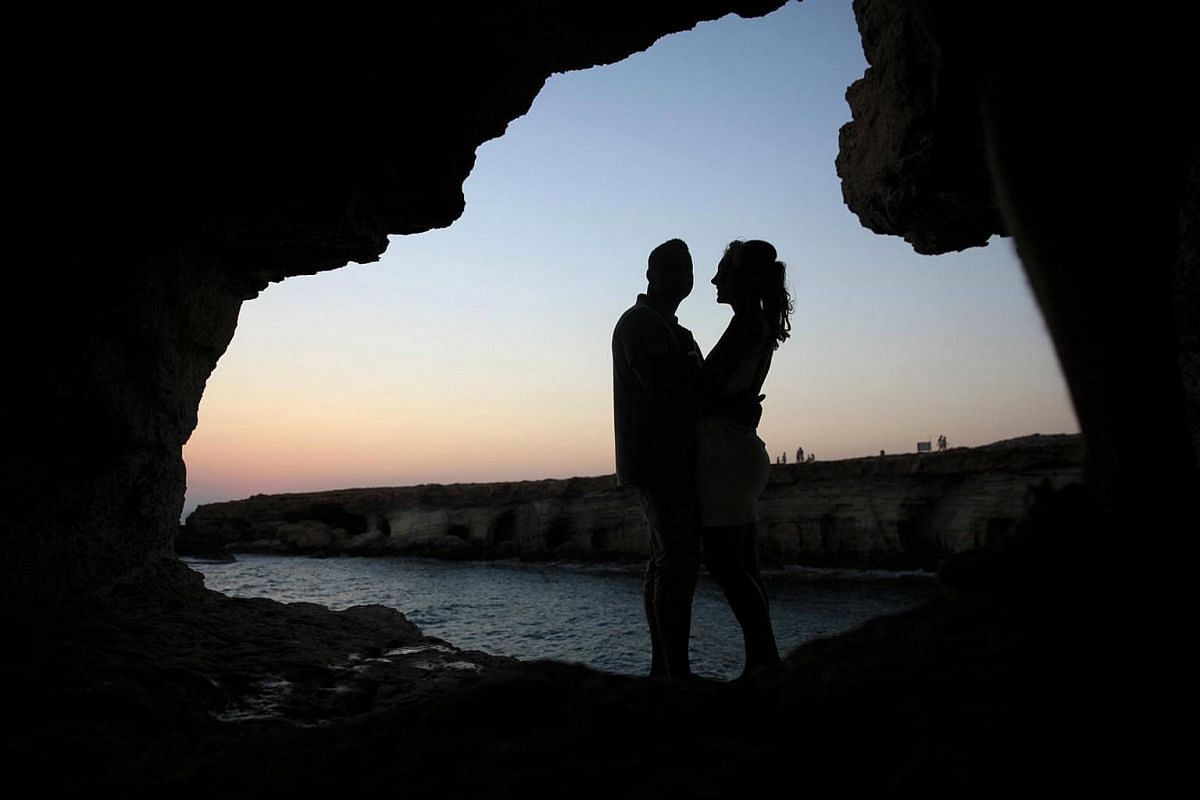 A couple hugs inside the sea caves at Cape Greco, Cyprus on August 9.