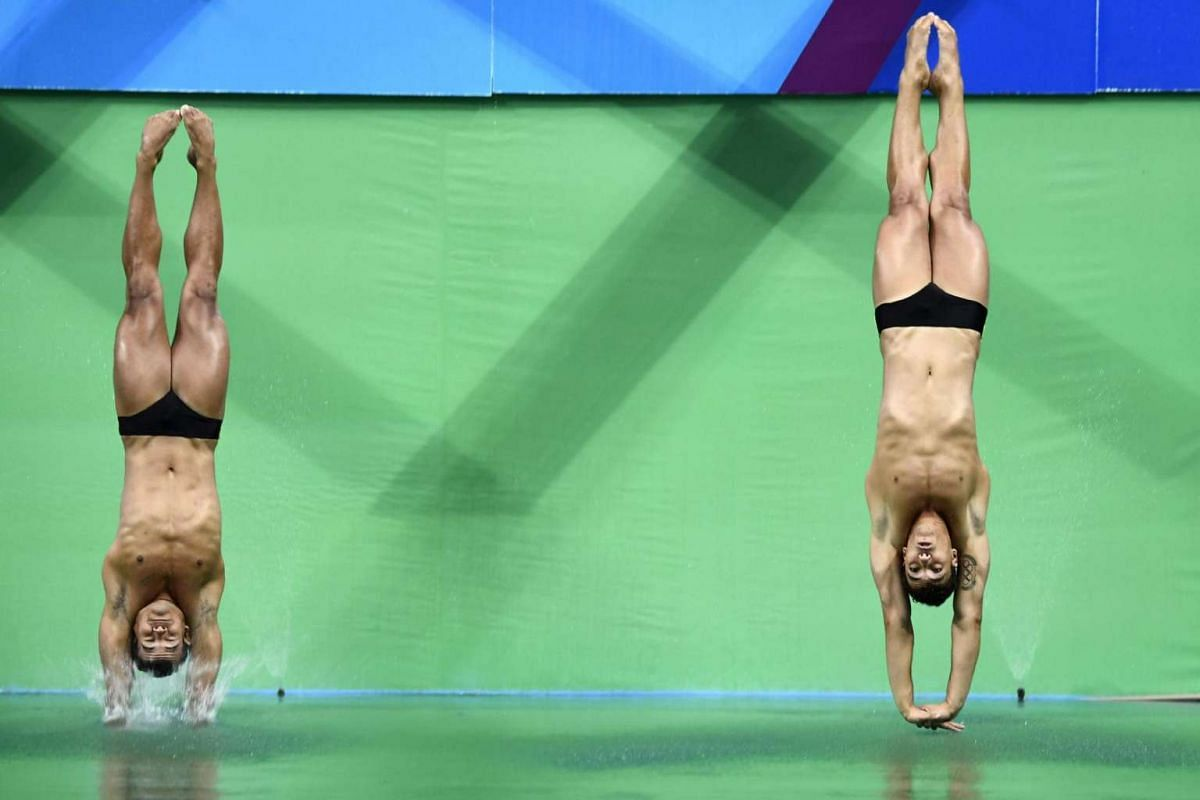 Brazil's Ian Carlos De Matos and Brazil's Luiz Felipe Outerelo compete in the men's synchronised 3m springboard final during the diving event at the Rio 2016 Olympic Games at the Maria Lenk Aquatics Stadium in Rio de Janeiro on Aug 10.